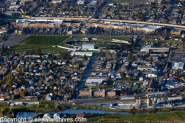 aerial photograph east Petaluma, Sonoma County, California, a portion of the Petaluma river an Shamrock Materials in the foreground, the Sonoma Marin Fairgrounds and the Petaluma Fairgrounds Speedway in the middleground and the East Washington Place shopping mall in the background