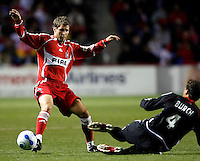 Chicago Fire midfielder Logan Pause (7) attempts to avoid a slide tackle by DC United defender Marc Burch (4). The Chicago Fire defeated D. C. United 1-0 during the first leg of the MLS Eastern Conference Semifinal Series at Toyota Park in Bridgeview, IL, on October 25, 2007.