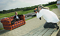 05/08/2004   Copyright Pic: James Stewart.File Name : jspa03_yerbury.PHOTOGRAPHER TREVOR YERBURY EMBARKS ON HIS SCOTLAND'S PEOPLE EXHIBITION AT THE FALKIRK WHEEL WITH HIS TARTAN SOFA AND THE HELP OF THE CANDIDATES FOR THE SNP LEADERSHIP, MIKE RUSSELL, ROSESANA CUNNINGHAM AND ALEX SALMOND......Payments to :.James Stewart Photo Agency 19 Carronlea Drive, Falkirk. FK2 8DN      Vat Reg No. 607 6932 25.Office     : +44 (0)1324 570906     .Mobile  : +44 (0)7721 416997.Fax         :  +44 (0)1324 570906.E-mail  :  jim@jspa.co.uk.If you require further information then contact Jim Stewart on any of the numbers above.........
