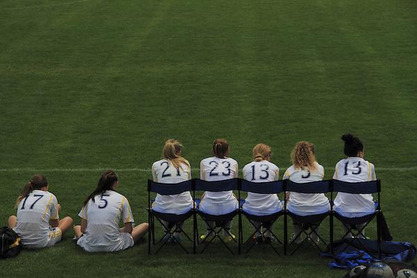 Bench warmers on a girls soccer team, Denver, Colorado, USA.