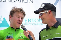 Tour MC Del Woodford talks with sprint winner Corbin Strong (left). Masterton-Alfredton road circuit - Stage Two of 2021 NZ Cycle Classic UCI Oceania Tour in Wairarapa, New Zealand on Wednesday, 13 January 2021. Photo: Dave Lintott / lintottphoto.co.nz