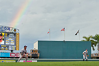 Tampa Tarpons third baseman Roberto Chirinos (14) and shortstop Trey Sweeney (4) in the field as a rainbow appears over the scoreboard during Game One of the Low-A Southeast Championship Series against the Bradenton Marauders on September 21, 2021 at LECOM Park in Bradenton, Florida.  (Mike Janes/Four Seam Images)
