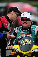 Nov. 10, 2011; Pomona, CA, USA; NHRA funny car driver Bob Tasca III (left) talks with John Force during qualifying at the Auto Club Finals at Auto Club Raceway at Pomona. Mandatory Credit: Mark J. Rebilas-..