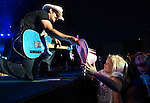 Brad Paisley signs a fan's hat while performing at the Harveys Lake Tahoe Outdoor Arena in Stateline, Nev., on Thursday, June 11, 2015. <br /> Photo by Cathleen Allison/Nevada Photo Source