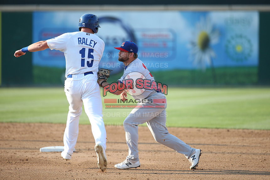 Nate Mondou (3) of the Stockton Ports tags out Luke Raley (15) of the Rancho Cucamonga Quakes during a game at Loan Mart Field on July 16, 2017 in Rancho Cucamonga, California. Rancho Cucamonga defeated Stockton 9-1. (Larry Goren/Four Seam Images)