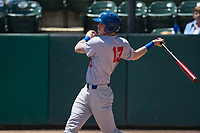 Stockton Ports designated hitter Jonah Heim (13) follows through on his swing during a California League game against the Visalia Rawhide at Visalia Recreation Ballpark on May 9, 2018 in Visalia, California. Stockton defeated Visalia 4-2. (Zachary Lucy/Four Seam Images)