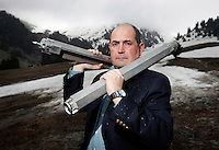 American-Ukrainian physicist Igor Bolshinsky holds two dummy fuel assemblies on a mountain near Almaty. The removal of Kazakhstan's highly enriched uranium (HEU) is part of the U.S. Global Threat Reduction Initiative (GTRI), where Bolshinsky works, which tries to secure nuclear material around the world to prevent their misuse.