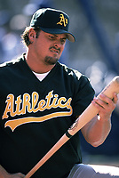 Jason Giambi of the Oakland Athletics during a 2000 season MLB game against the  Los Angeles Angels at Angel Stadium in Anaheim, California. (Larry Goren/Four Seam Images)