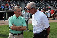 Atlanta Braves General Manager John Hart, right, talks with club President John Schuerholz around the batting cage before a Spring Training game against the New York Yankees on Wednesday, March 18, 2015, at Champion Stadium at the ESPN Wide World of Sports Complex in Lake Buena Vista, Florida. The Yankees won, 12-5. (Tom Priddy/Four Seam Images)