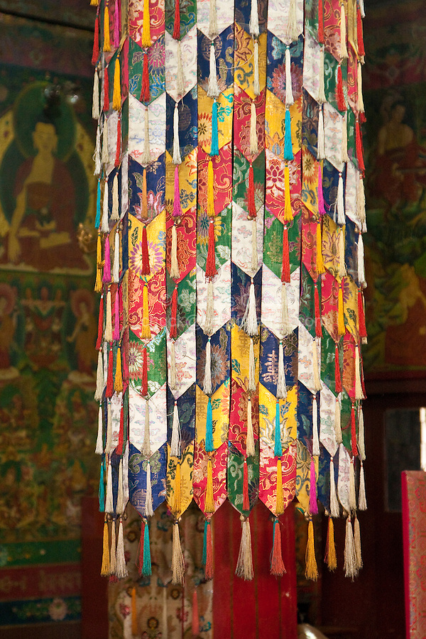 Bodhnath, Nepal.  Tassels and Fabric Decorating the inside of the Tsamchen Gompa (Tibetan Buddhist Monastery).