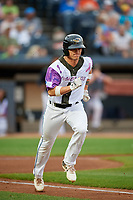 "Akron RubberDucks Alex Call (7) runs to first base during an Eastern League game against the Erie SeaWolves on August 30, 2019 at Canal Park in Akron, Ohio.  Akron wore special jerseys with the slogan ""Fight Like a Kid"" during the game for Akron Children's Hospital Home Run for Life event, the design was created by 11 year old Macy Carmichael.  Erie defeated Akron 3-2.  (Mike Janes/Four Seam Images)"