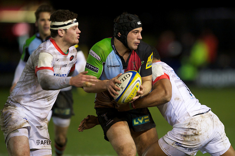 Ollie Lindsay-Hague of Harlequins 'A' offloads as he is tackled by Duncan Taylor of Saracens Storm during the Aviva Premiership A League Final between Harlequins A and Saracens Storm at the Twickenham Stoop on Monday 17th December 2012 (Photo by Rob Munro)