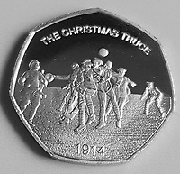 BNPS.co.uk (01202 558833)<br /> Pic: Pen&Sword/BNPS<br /> <br /> Pictured: The Christmas Truce commemorative coin.<br /> <br /> Previously unseen accounts of the First World War Christmas Day truce from the German side have come to light over 100 years on.<br /> <br /> British historian Anthony Richards has pored over hundreds of German diaries to shed new light on the temporary ceasefire in 1914.<br /> <br /> The fascinating accounts include one by a soldier who described the truce as a 'miracle' and called enemy troops his 'brothers'.