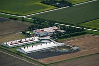 GERMANY aerial view of farm homestead with slurry tank in Northern Germany  / DEUTSCHLAND, Luftaufnahmen von Farmbetrieben in Schleswig-Holstein, Hof mit Solardaechern und Gülle Tank