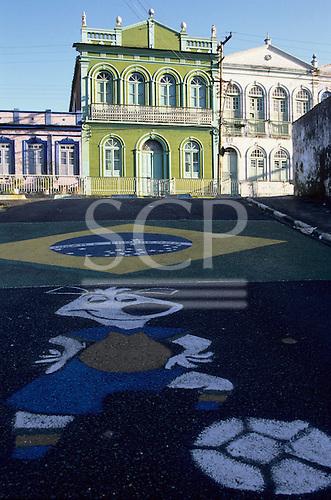 Salvador, Bahia, Brazil. Pavement art; footballing cartoon and the Brazilian flag in Cidade Alta.