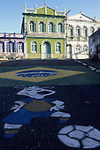 Salvador, Bahia, Brazil. Pavement art; footballing cartoon and the Brazilian flag in Cidade Alta.