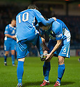 Queen of the South's Nicky Clark (10) celebrates with Derek Young (6) after he scores their second goal.