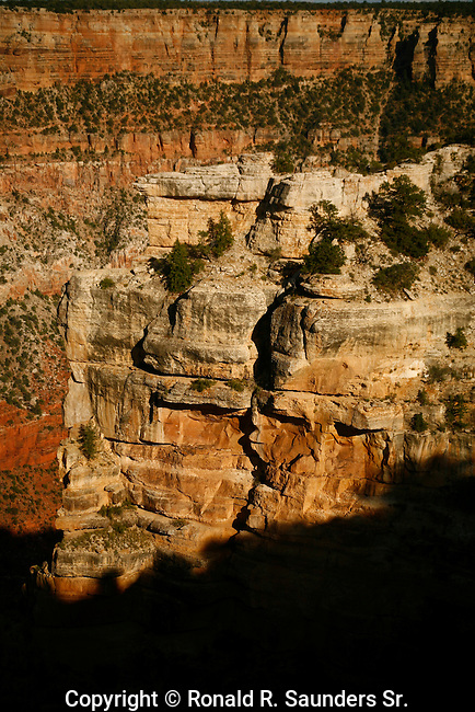 Rock wall extends into southern rim of the Grand Canyon at sundown.<br /> (5)