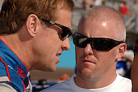 Nov 12, 2005; Phoenix, Ariz, USA;  Nascar Nextel Cup driver Rusty Wallace talks with CART driver Paul Tracy prior to qualifying for the Checker Auto Parts 500 at Phoenix International Raceway. Mandatory Credit: Photo By Mark J. Rebilas