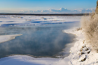 Open water on the Tanana River during early march, Alaska mountain range in the distance, Delta Junction, Alaska.