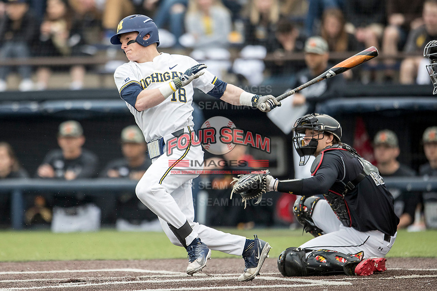 Michigan Wolverines shortstop Jack Blomgren (18) follows through on his swing against the Maryland Terrapins on April 13, 2018 in a Big Ten NCAA baseball game at Ray Fisher Stadium in Ann Arbor, Michigan. Michigan defeated Maryland 10-4. (Andrew Woolley/Four Seam Images)