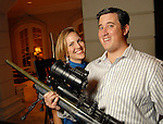 Josh and Tracy Popes with one of the SWAT teams sniper rifles at the Second Annual True Blue Gala sponsored by the Houston Police Foundation at the home of Paige and Tilman Fertitta Saturday Oct. 17,2009. (Dave Rossman/For the Chronicle)