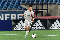 FOXBOROUGH, MA - JULY 23: Nicolas Ovalle #51 of Toronto FC II brings the ball forward during a game between Toronto FC II and New England Revolution II at Gillette Stadium on July 23, 2021 in Foxborough, Massachusetts.
