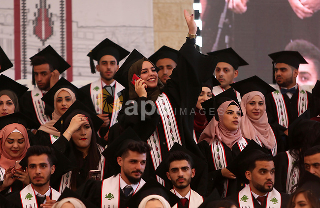 Palestinian students attend their graduation ceremony at the Birzeit University in the West Bank city of Ramallah, June 24, 2018. Photo by Shadi Hatem