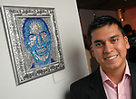 """Artist Sergio Aleman Jr. with his piece """"Vote"""" depicting Obama at the Red Bull Art of Can exhibit opening party at The Galleria Friday July 11,2008."""