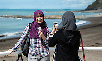 Aberystwyth, West Wales, UK Weather: Two young women enjoy an ice cream whilst taking a selfie in Aberystwyth Promenade.