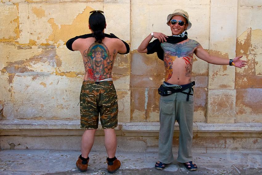 Japanese Tourist showing off their tattoos in Bikaner, Rajasthan India