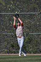 Blake Rutherford (24) of Chaminade High School catches a fly ball during a game against Harvard Westlake High School at O'Malley Field on March 16, 2016 in Encino, California. (Larry Goren/Four Seam Images)