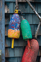 Colorful lobster buoys on a coastal shack, Maine, USA