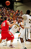 21 January 2010: University of Vermont Catamount forward Marqus Blakely, a Senior from Metuchen, NJ, is fouled during a game against the Stony Brook University Seawolves at Patrick Gymnasium in Burlington, Vermont. The Catamounts fell to the Seawolves 65-60 in the America East matchup. Mandatory Credit: Ed Wolfstein Photo