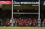 The Wales team line up behind the posts as Australia outside half Bernard Foley kicks a conversion.<br /> Dove Men Series 2014<br /> Wales v Australia<br /> Millennium Stadium<br /> 08.11.14<br /> ©Steve Pope-SPORTINGWALES