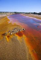 - Il Rio Tinto, fiume del sud-ovest della Spagna, che ha origine nelle montagne della Sierra Morena in Andalusia, raggiungendo il Golfo di Cadice presso la città di Huelva. Il Tinto si distingue per presentare un'elevata acidità delle sue acque ed una profonda tonalità rossastra, causata dal ferro disciolto. L'acidità porta a gravi problemi ambientali a causa delle concentrazioni di metalli pesanti nel fiume.<br /> <br /> - The Rio Tinto, river in south-west Spain, which originates in the mountains of the Sierra Morena in Andalusia,<br /> reaching the Gulf of Cadiz at the city of Huelva. The Tinto is distinguished for presenting a high acidity of the water and a deep reddish hue, caused by dissolved iron. The acidity leads to serious environmental problems due to the heavy metal concentrations in the river.