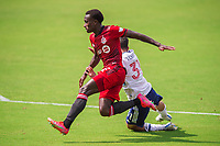ORLANDO, FL - APRIL 24: Richie Laryea #22 of Toronto FC battles for the ball during a game between Vancouver Whitecaps and Toronto FC at Exploria Stadium on April 24, 2021 in Orlando, Florida.