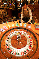 A roulette wheel dealer shortly at the 'MGM Grand Macau' casino  Macau. The ex-Portuguese colony of Macau in South China is a mecca for gamblers in Asia and especially China and makes more money that Las Vegas.