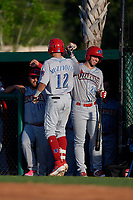 Clearwater Threshers Simon Muzziotti (12) celebrates with Matt Vierling (28) after hitting a home run during a Florida State League game against the Dunedin Blue Jays on May 11, 2019 at Jack Russell Memorial Stadium in Clearwater, Florida.  Clearwater defeated Dunedin 9-3.  (Mike Janes/Four Seam Images)