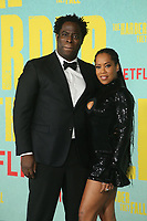 LOS ANGELES, CA - OCTOBER 13: Jeymes Samuel and Regina King at the Special Screening Of The Harder They Fall at The Shrine in Los Angeles, California on October 13, 2021. Credit: Faye Sadou/MediaPunch