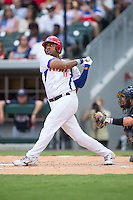 Urmany Guerra Vargas (17) of the Cuban National Team follows through on his swing against the US Collegiate National Team at BB&T BallPark on July 4, 2015 in Charlotte, North Carolina.  The United State Collegiate National Team defeated the Cuban National Team 11-1.  (Brian Westerholt/Four Seam Images)