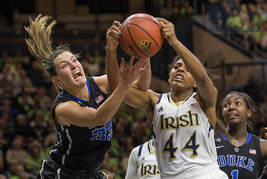 Feb. 21, 2014; Ariel Braker battles for the ball against Duke forward Haley Peters during the second half. Notre Dame won 81 to 70. Photo by Barbara Johnston/University of Notre Dame