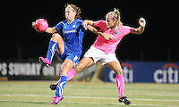 Boston forward, Lauren Cheney (8) brings the ball down under pressure from Philadelphia defender, Allison Falk (3).  The Philadelphia Independence and Boston Breakers played to a 2-2 tie at John A Farrell Stadium in West Chester, Pennsylvania.