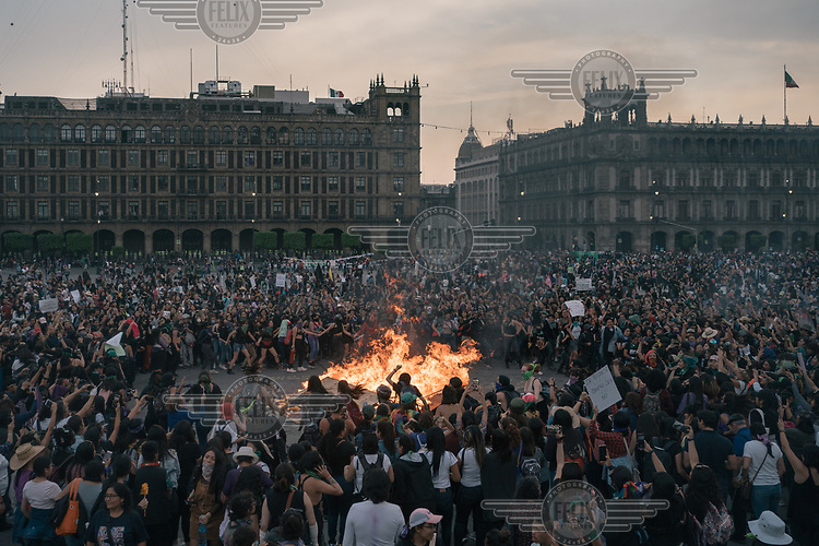 Demonstrators gather around a fire made out of wood barriers, aerosol spray cans, banners and bras in the Zocalo Plaza on International Women's Day. The annual demonstrationintensified and turned into a bigger movementagainst gender-based violenceamid an increase in killings of women and girls.