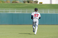 Peoria Javelinas center fielder Cristian Pache (27), of the Atlanta Braves organization, jogs onto the field between innings of an Arizona Fall League game against the Surprise Saguaros at Surprise Stadium on October 17, 2018 in Surprise, Arizona. (Zachary Lucy/Four Seam Images)