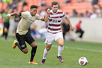 Houston, TX - Friday December 11, 2016: Logan Gdula (17) of the Wake Forest Demon Deacons and Sam Werner (23) of the Stanford Cardinal battle for control of the ball at the NCAA Men's Soccer Finals at BBVA Compass Stadium in Houston Texas.