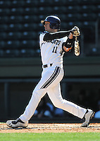 Catcher Jake Straub (11) of the Northwestern Wildcats hits in a game against the Michigan State Spartans on Sunday, February 17, 2013, at Fluor Field at the West End in Greenville, South Carolina. Michigan State won, 7-4. (Tom Priddy/Four Seam Images)