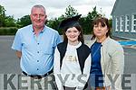 Aine Reidy graduating from Scoil NuachabháilNS in Ballymac on Thursday standing with her parents Denis and Sarah Reidy.