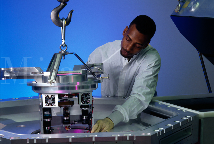Man working with hi-tech equipment.