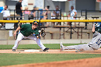 Clinton LumberKings third baseman Joseph DeCarlo (5) takes a throw as pinch runner Branden Cogswell (13) slides into third during a game against the Beloit Snappers on August 17, 2014 at Ashford University Field in Clinton, Iowa.  Clinton defeated Beloit 4-3.  (Mike Janes/Four Seam Images)